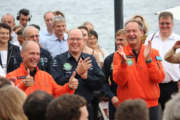 Bertrand Piccard, HSH Prince Albert II and André Borschberg congratulating Solar Impulse 2 team July 29 at MYC . Photo: ML