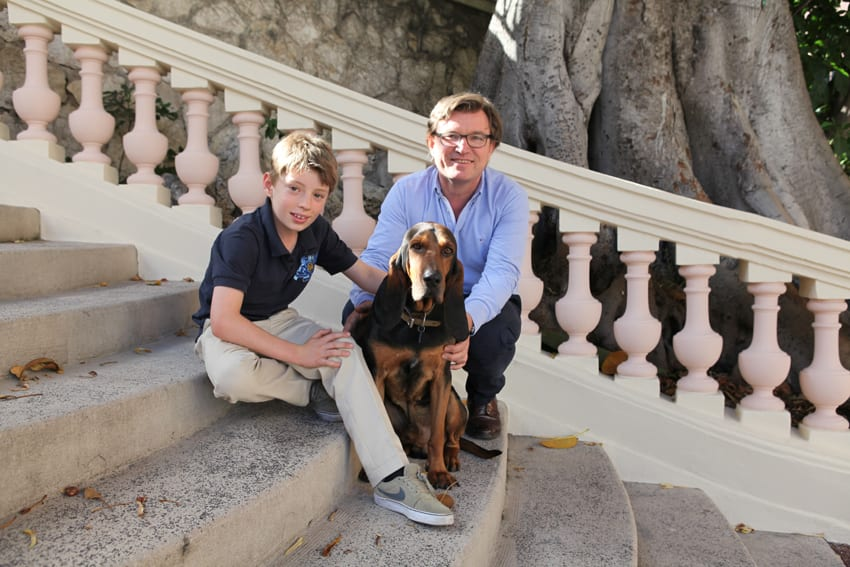 Max the Hound with his owners, Dr Pierre Burghgraeve and his son Raphael