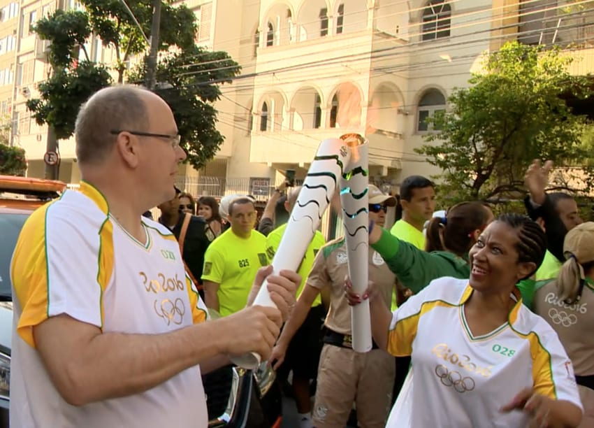 Prince Albert passing the Olympic torch. Photo: Stéphan Maggi/Comité Olympique Monégasque