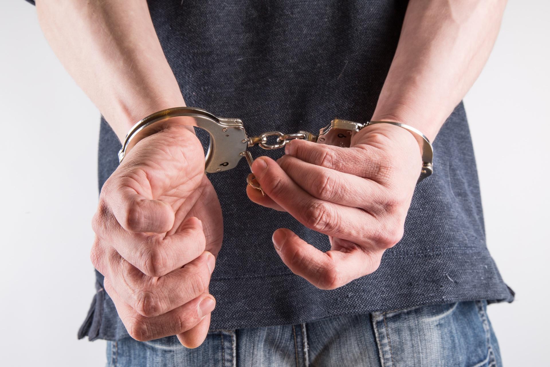 hands-in-handcuffs-1462608479r21