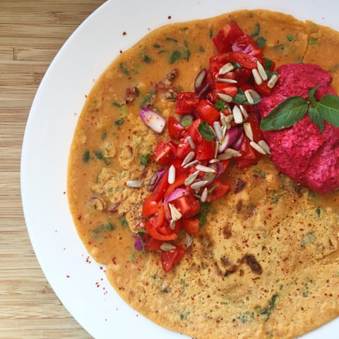 Naomi's spicy socca with beetroot hummus and a salad of cherry tomatoes, basil and spring onions.