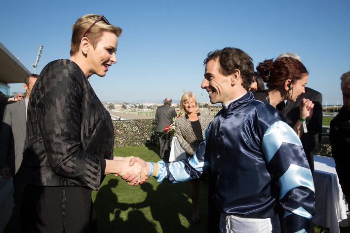 Princess Charlene congratulates Ronan Thomas whose horse Miracle des Aigles came first, winning €10,000 for Monaco's Action Inncocence. Photo: Kasia Wandycz/Palais Princier