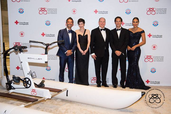 (L-R): Pierre Frolla, Ambassador for the Princess Charlene of Monaco Foundation, Agnès Falco, Secretary General of the Princess Charlene of Monaco Foundation, HSH Prince Albert II, Bruno Senna, Ambassador for the Princess Charlene of Monaco Foundation, and Jo-Ann Strauss, Master of Ceremonies Photo: © Eric Mathon / Palais Princier