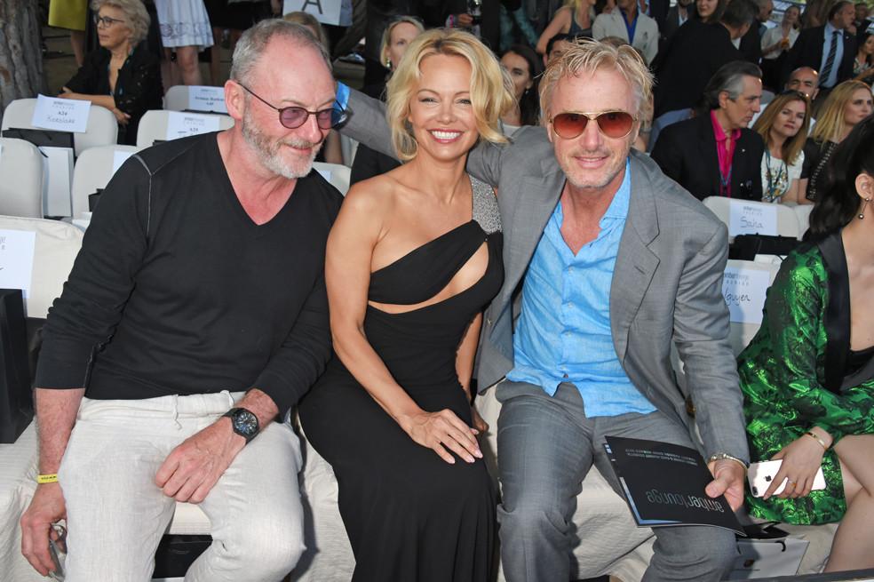Liam Cunningham, Pamela Anderson and Eddie Irvine. Photo: Dave Benett