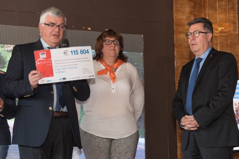 Dr Bourlon of the Cardio-Thoracic Centre of Monaco holding a cheque next to the Centre's Director Mr Nervo.