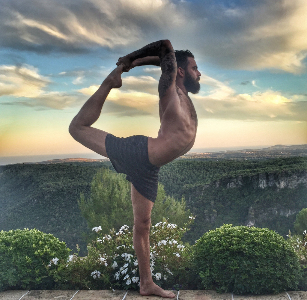 Ben Sears in yoga pose at Lux Villa
