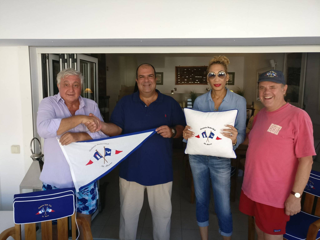Commodore Stelios shaking hands with the Commodore of the Anguilla Yacht Club at GYC clubhouse. Members are encouraged to go visit and take a picture with the Burgee in Anguilla and post back here. Photo: Facebook Gustavia Yacght Club