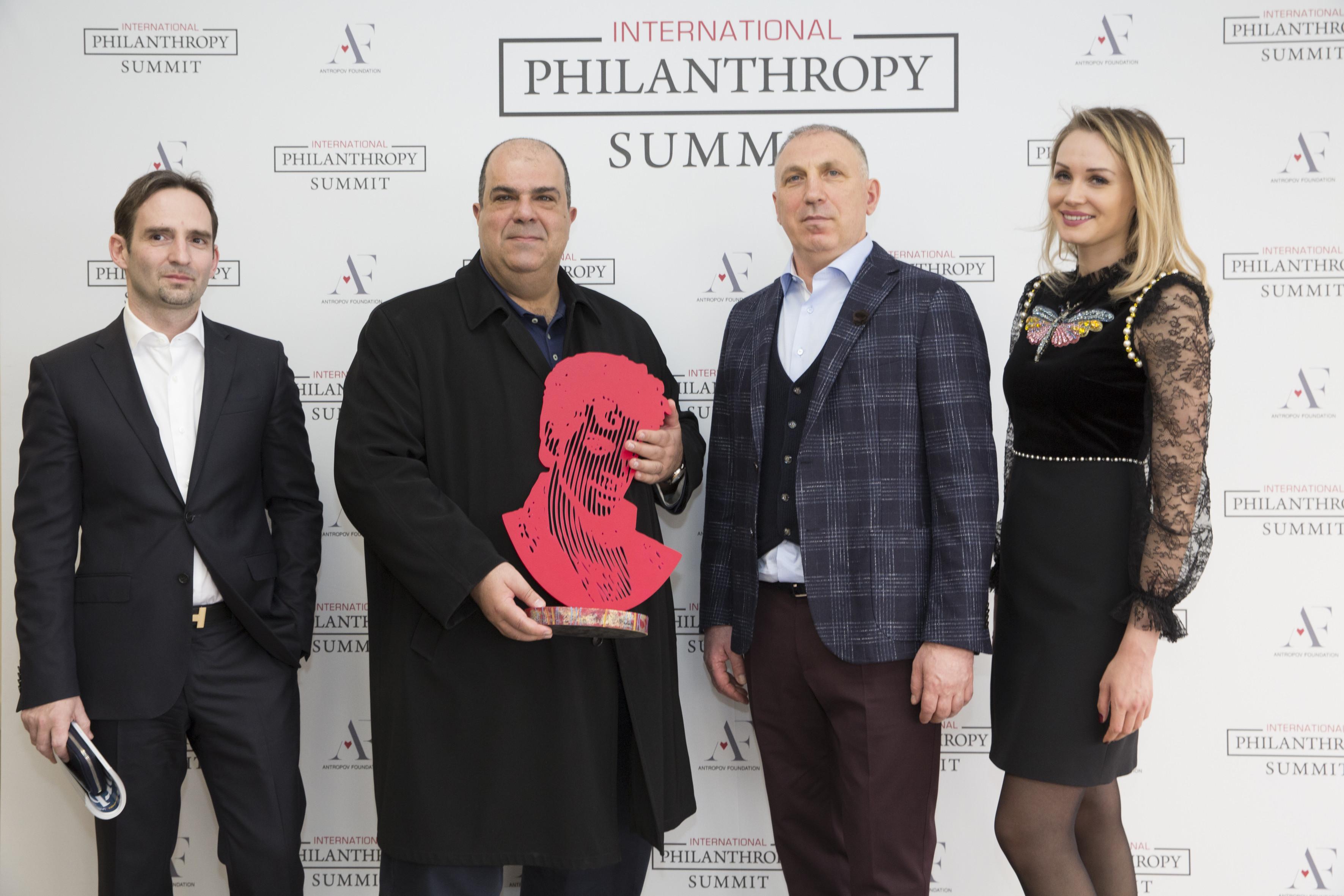 Alexey Antropov, Sir Stelios, Aya Glagoleva, Ambassador of the Antropov Foundation, and Vladimir Lyaporov. Photo: International Philanthropy Summit Monaco.