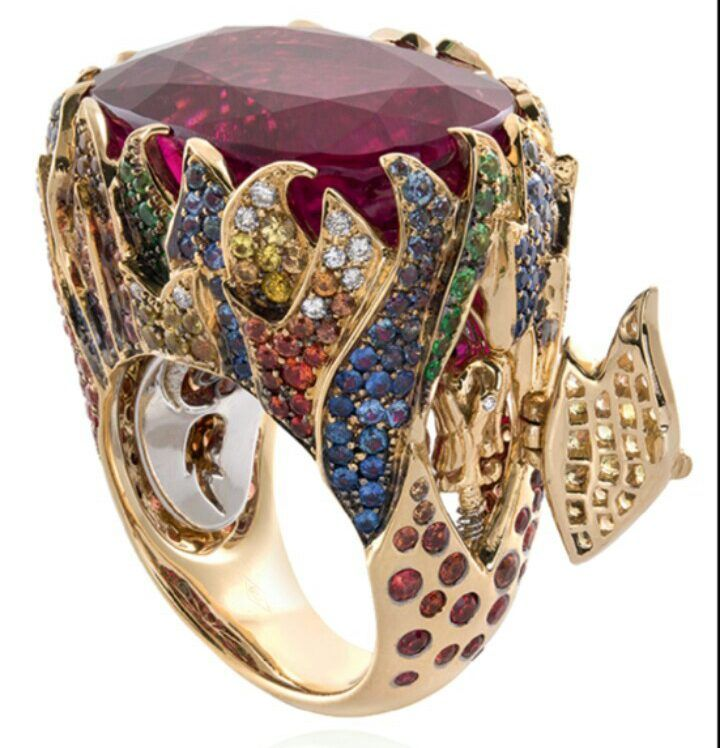 Alessio Boschi Flames Rubelite Ring in 18k gold set with rubellite (28.38ct), colourless diamonds (0.39ct), black diamonds (0.07ct), tsavorite (0.39ct), yellow sapphire (0.96ct), blue sapphire (0.98ct), and orange sapphire (1.74ct)
