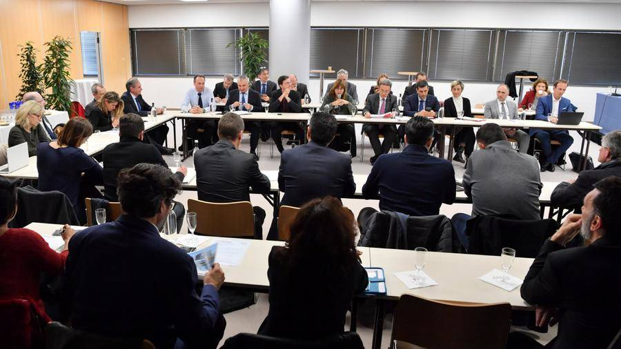 Members of the commission meeting around a table in Monaco