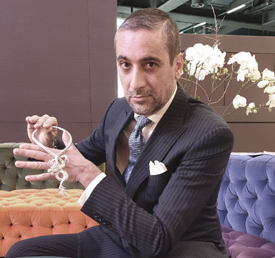 Photo: Antonio Cecere at Roberto Coin holding the Dragon Necklace (27.00ct white diamonds and rubies)